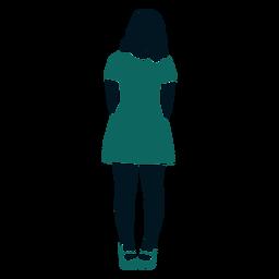 Retro 60s chica de pie manos detrás de la espalda