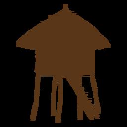 Silueta de cabaña de bambú en la playa