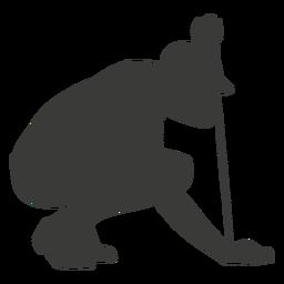 Silueta de jugador de golf agachado