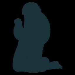 Kneeling man silhouette