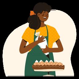 Frau, die einen Kuchencharakter verziert