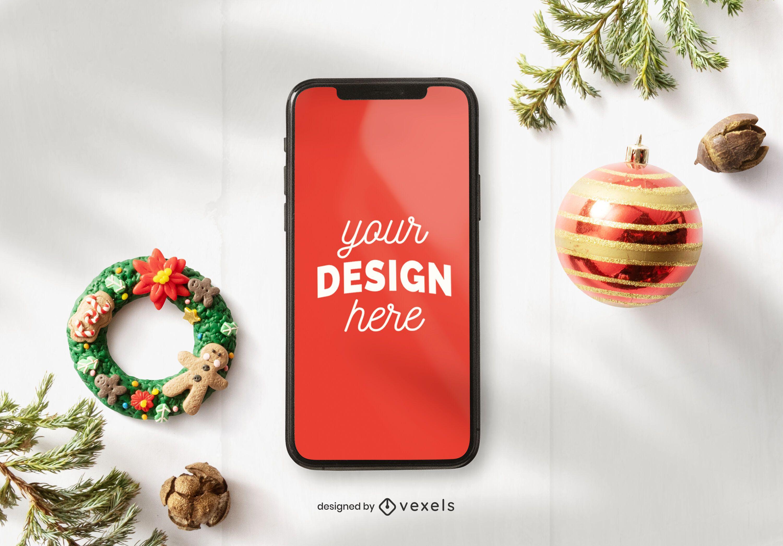 Composición de maqueta de Iphone de Navidad