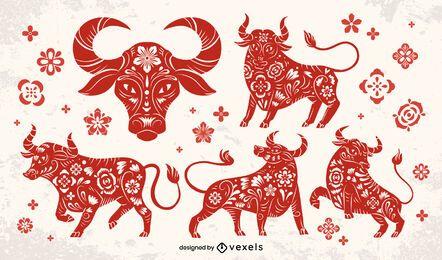 Conjunto de touro cortado em papel de ano novo chinês