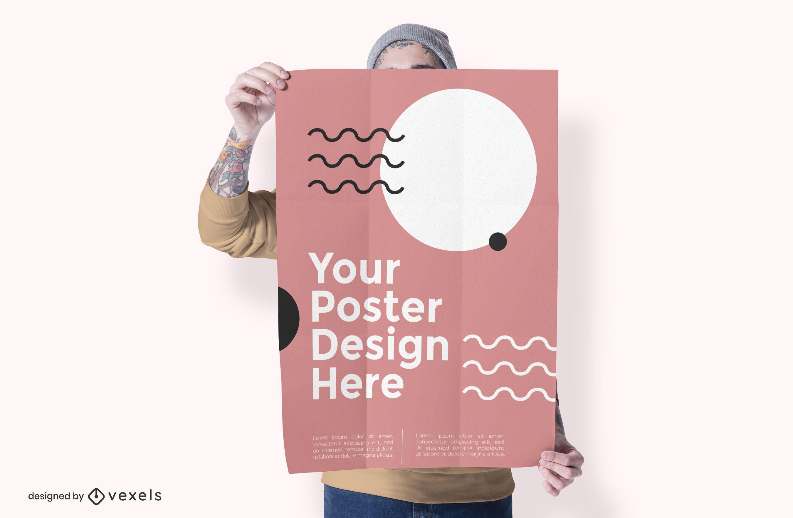 Hombre que sostiene el diseño de maqueta de cartel