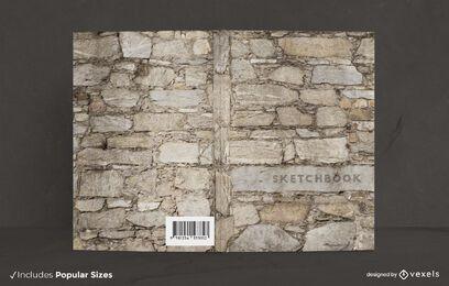 Diseño de portada de libro de pared de piedra