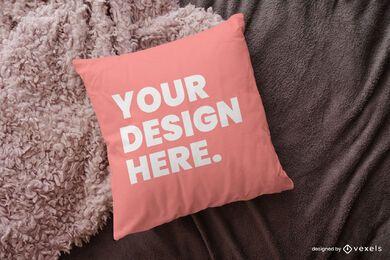 Desenho de maquete de travesseiro sobre cobertor