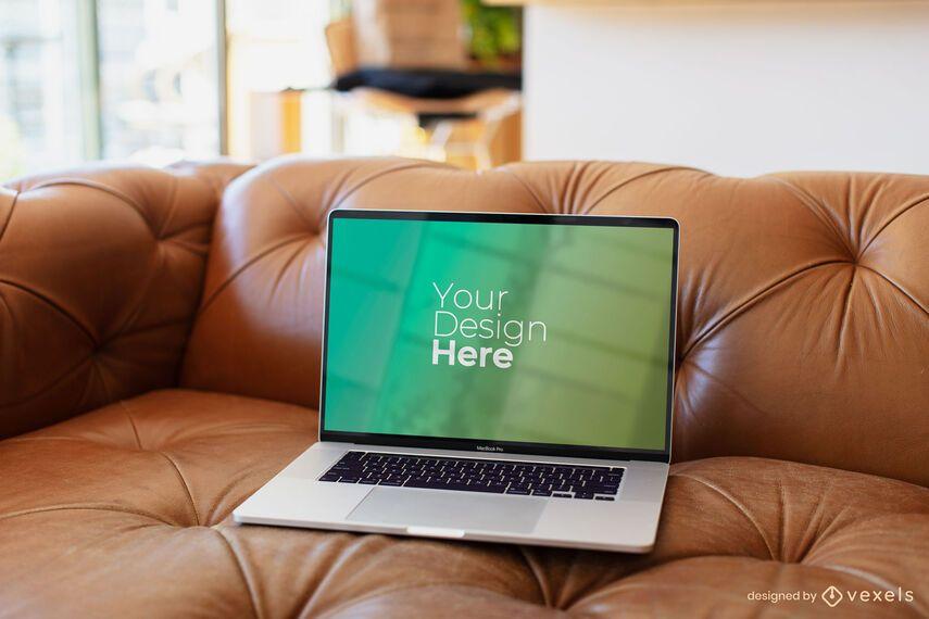Macbook laptop on brown sofa mockup