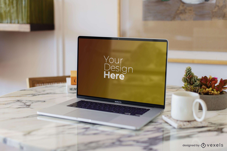Macbook laptop on marble table mockup