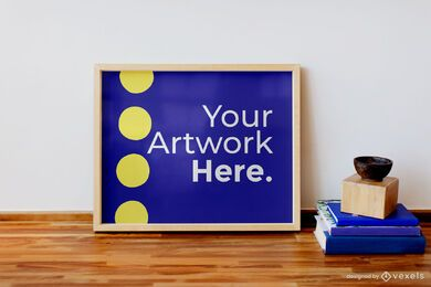 Artwork frame on table with books mockup