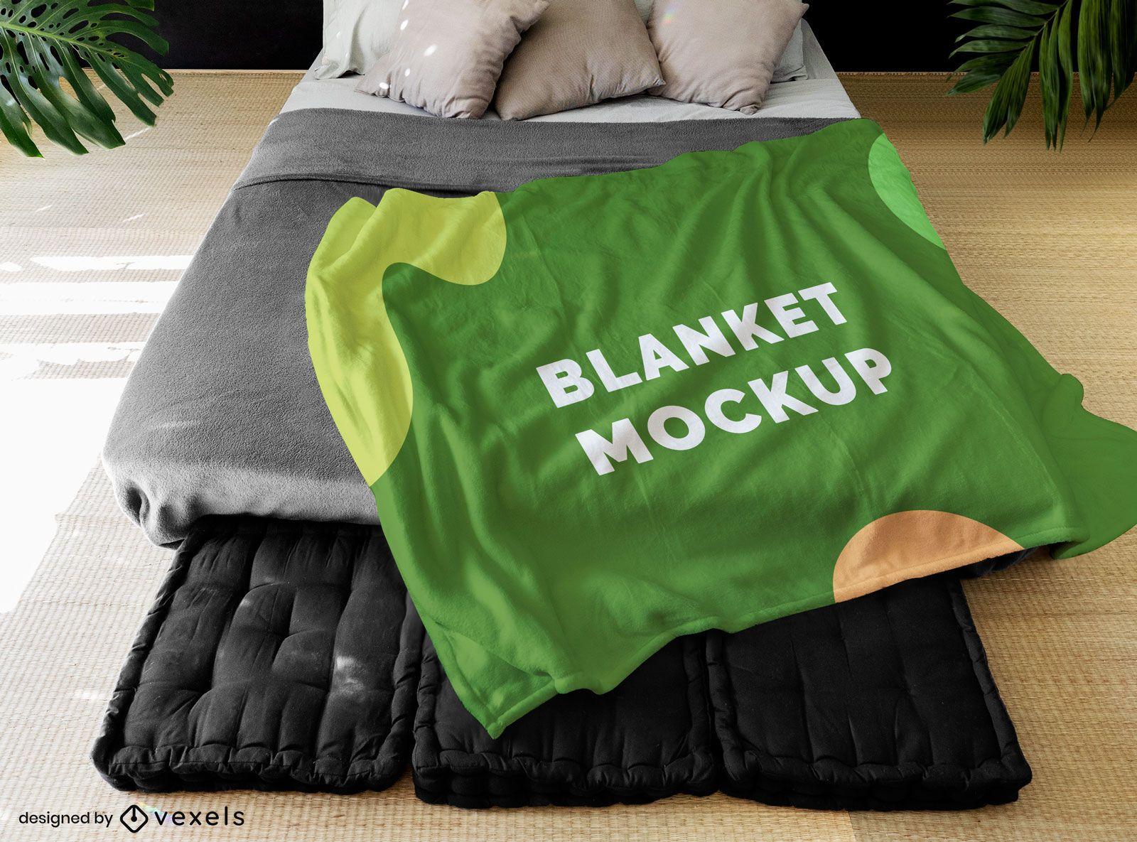 Jogue o cobertor na maquete do quarto da cama