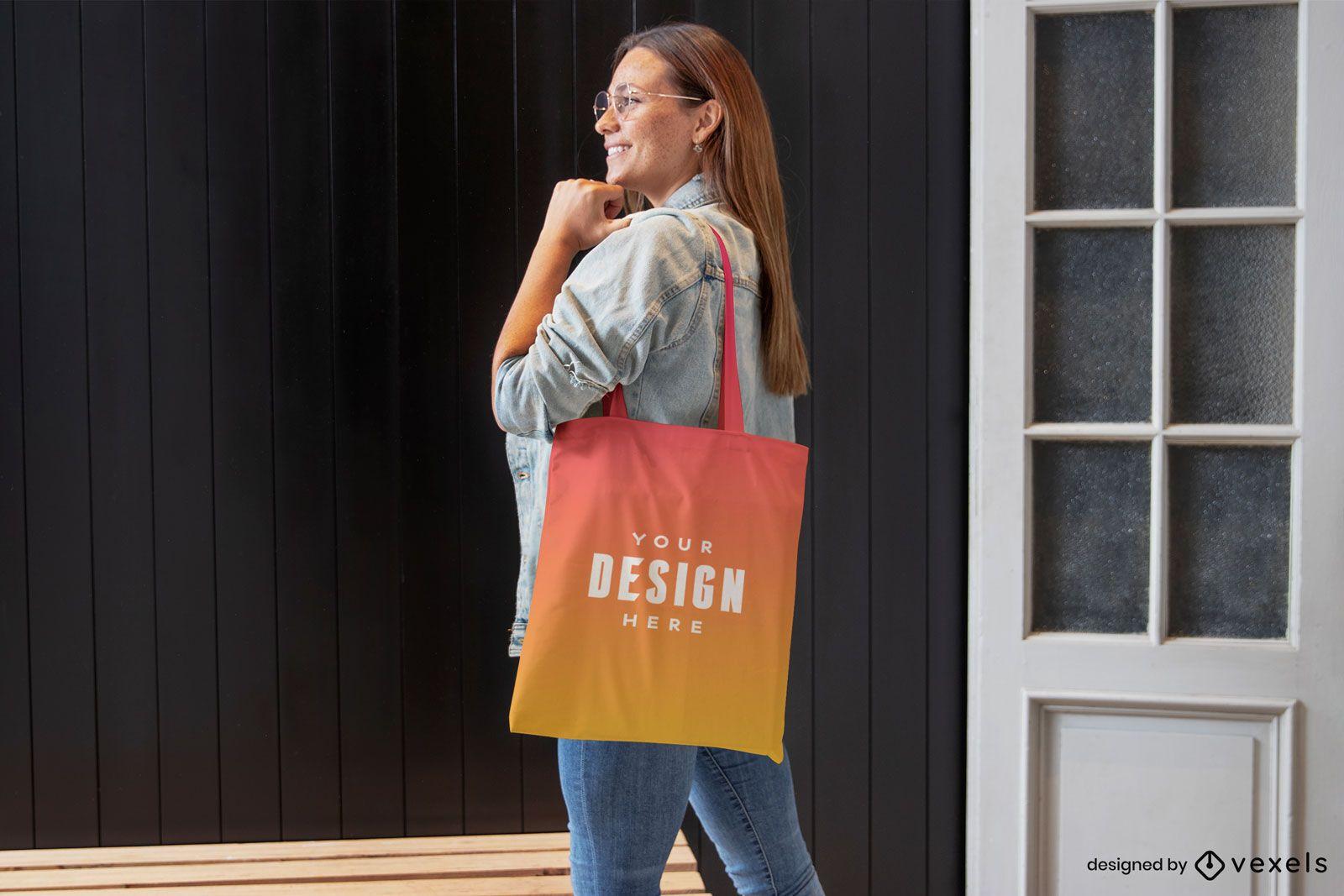 Woman in jean jacket tote bag mockup