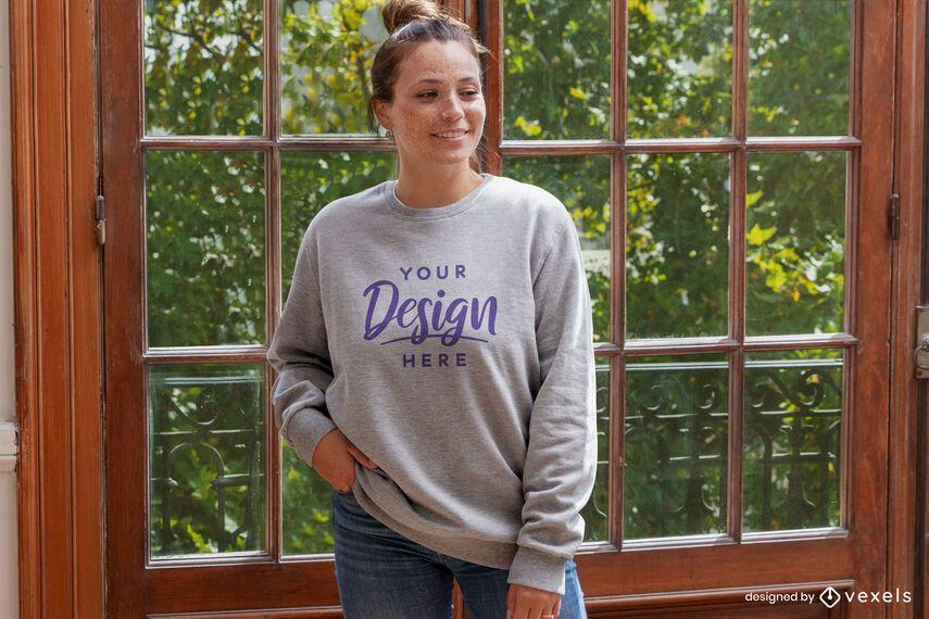 Woman against closed window sweatshirt mockup