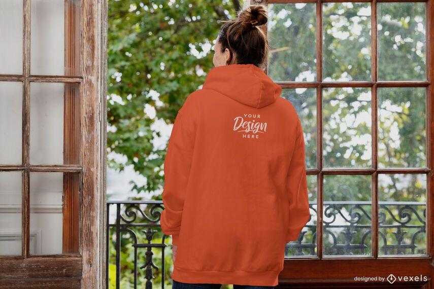 Woman backwards open window hoodie mockup