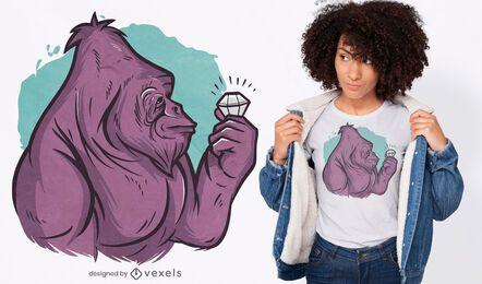 Gorila segurando o desenho de uma camiseta com diamantes