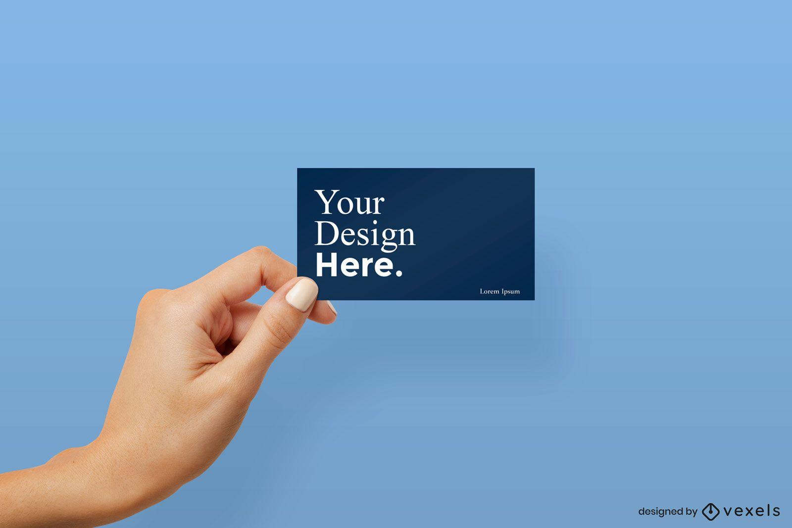 Mão esquerda segurando a maquete do cartão de visita