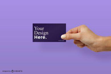 Mão direita segurando a maquete do cartão de visita