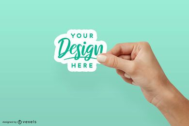 Right hand holding sticker mockup