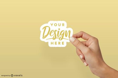Hand over solid background sticker mockup