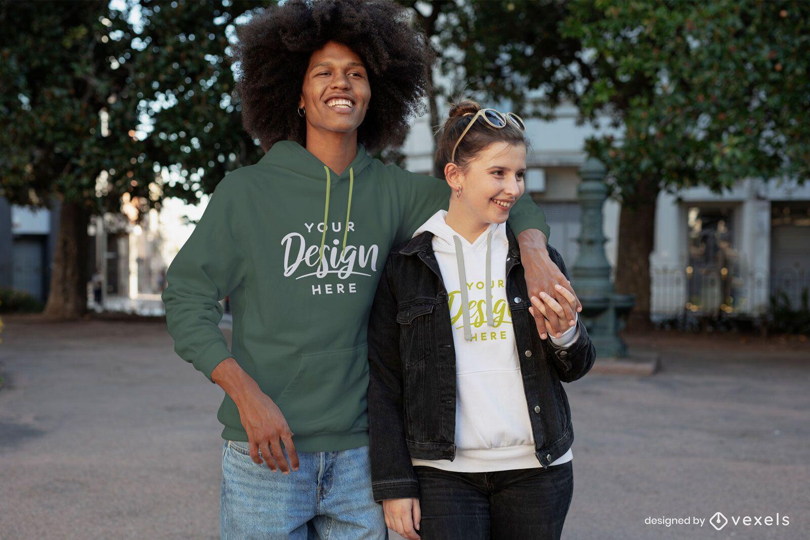 Feliz pareja cogidos de la mano maqueta de sudadera con capucha