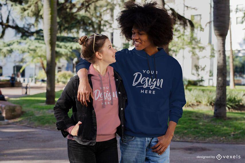 Happy couple walking through park hoodie mockup