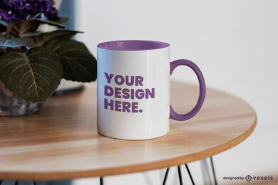 Mug on round wooden table mockup design