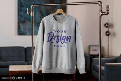 Sweatshirt hanging in living room mockup