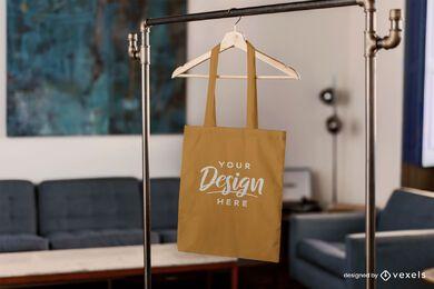 Tote bag hanging in living room mockup