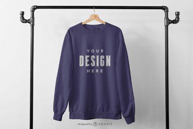 Sweatshirt hanging from black rack mockup