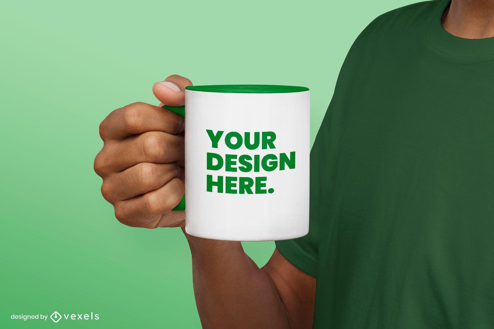 Maqueta de taza de mano verde simple sosteniendo