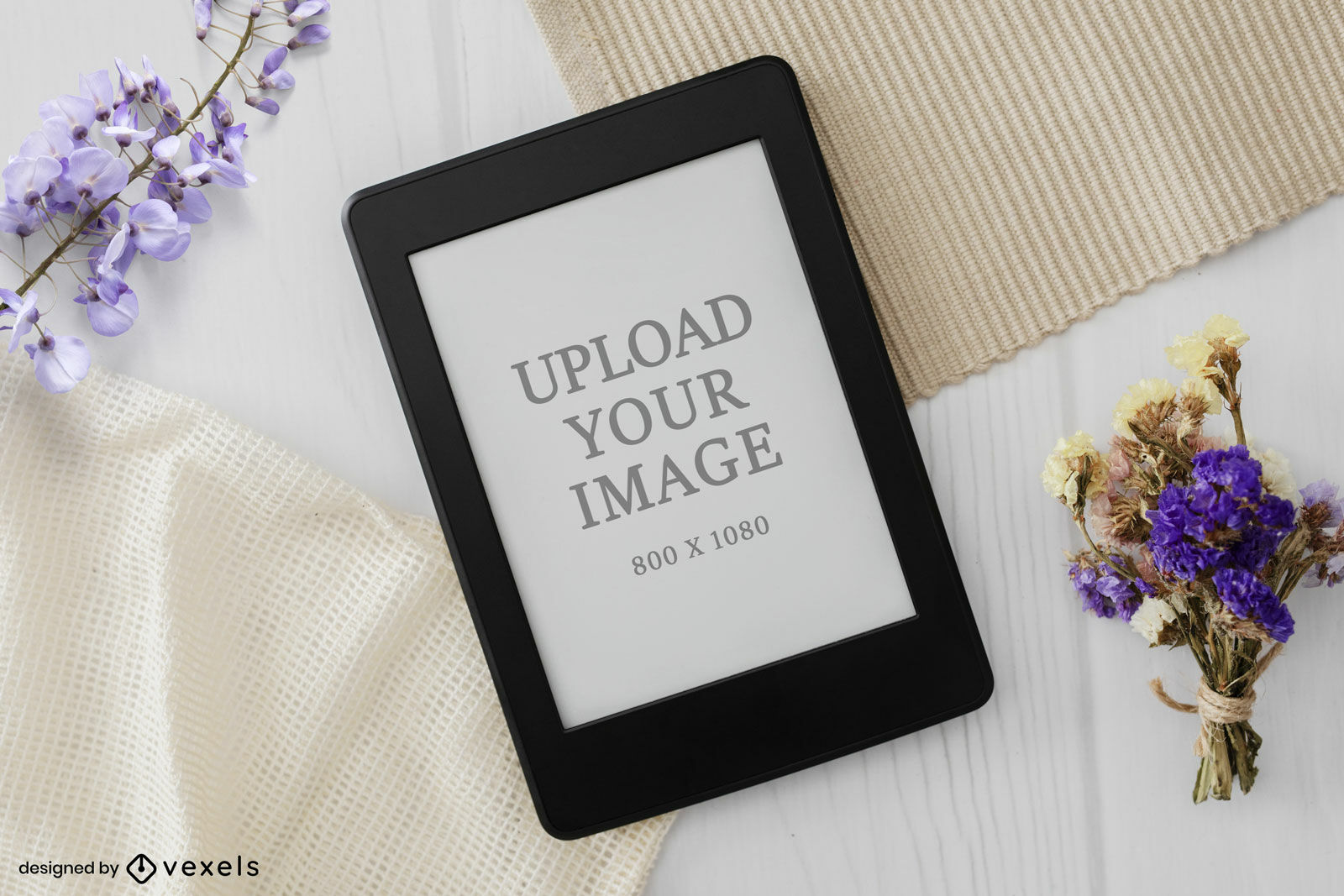 Kindle mockup table and flowers from top