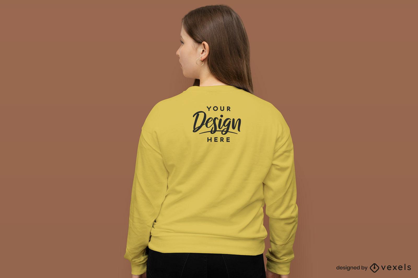 Girl in sweatshirt back yellowe background mockup