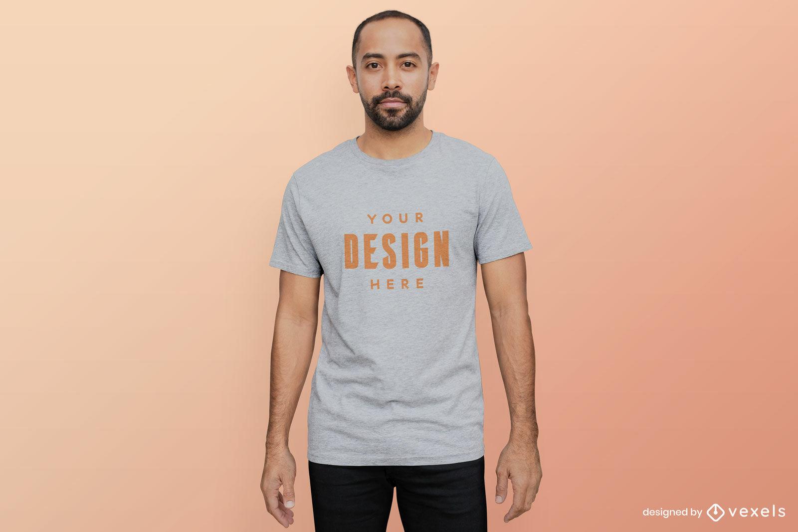 Man in grey t-shirt mockup orange background