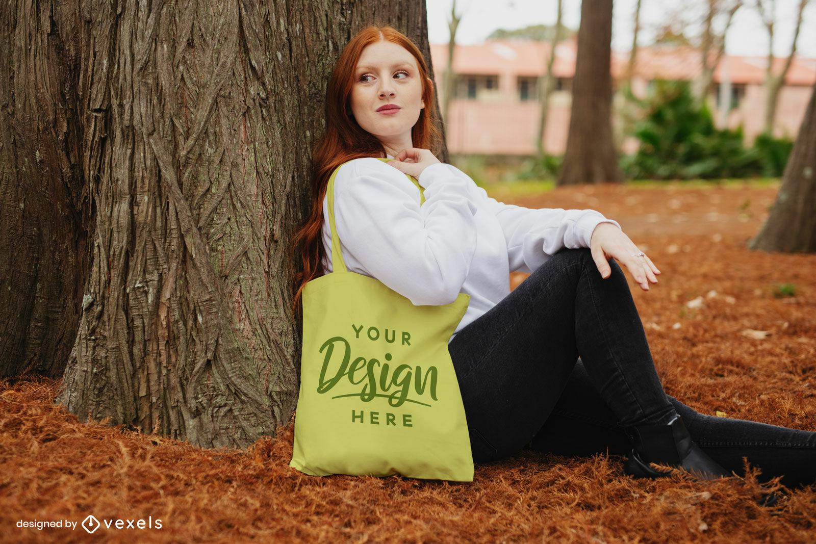 Autumn redhead sitting on park tote bag mockup