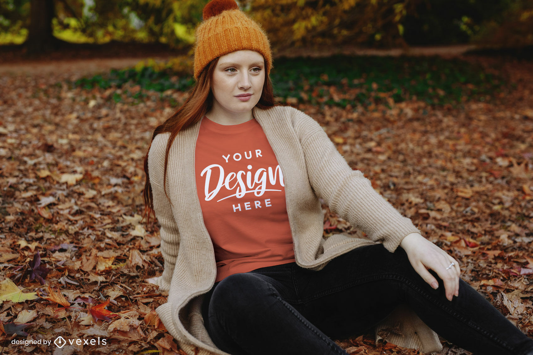Redheaded girl sitting on fall leaves t-shirt mockup