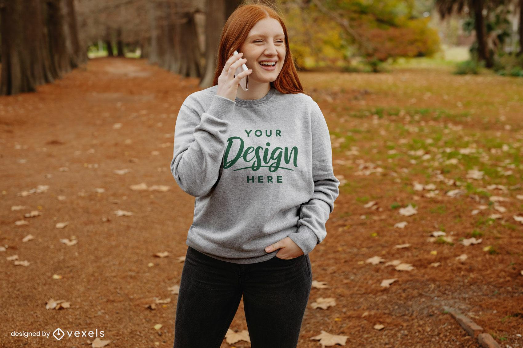 Ginger on phone fall park sweatshirt mockup