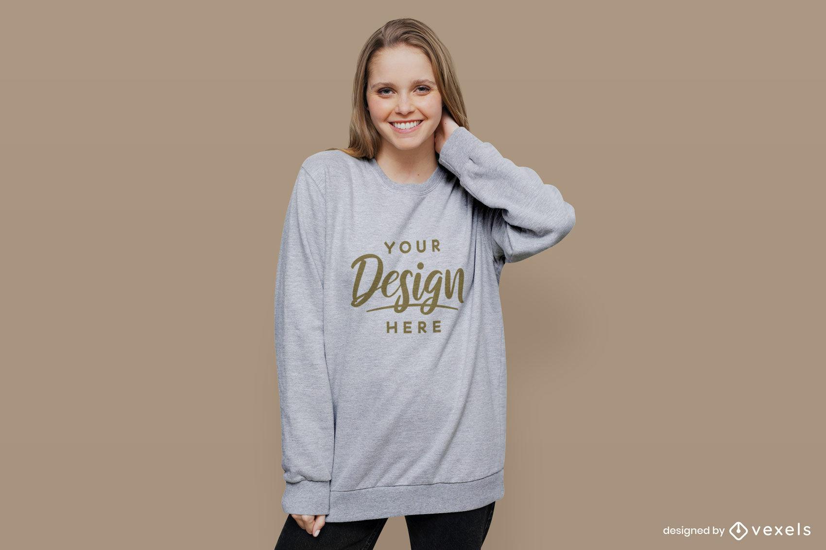 Graues Sweatshirt-Mädchenmodell im flachen Hintergrund