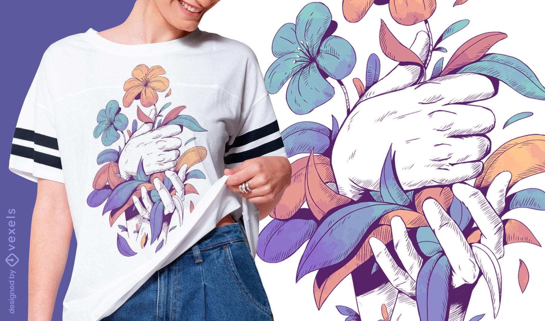 Manos sosteniendo flores y hojas diseño de camiseta psd
