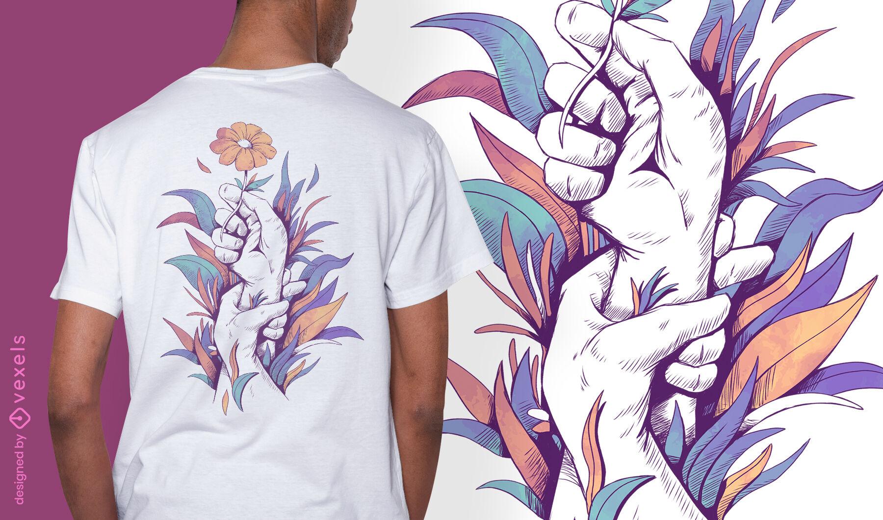Mãos segurando um desenho de t-shirt psd de flor