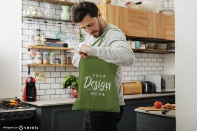 Man in kitchen green tote bag mockup