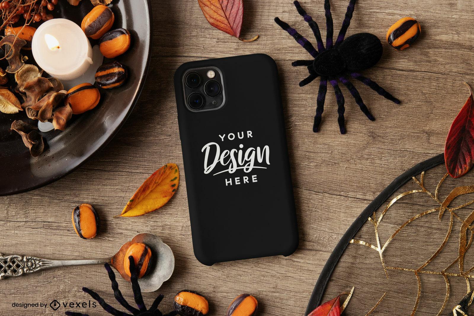 Capa de celular preta com maquete de composição de halloween