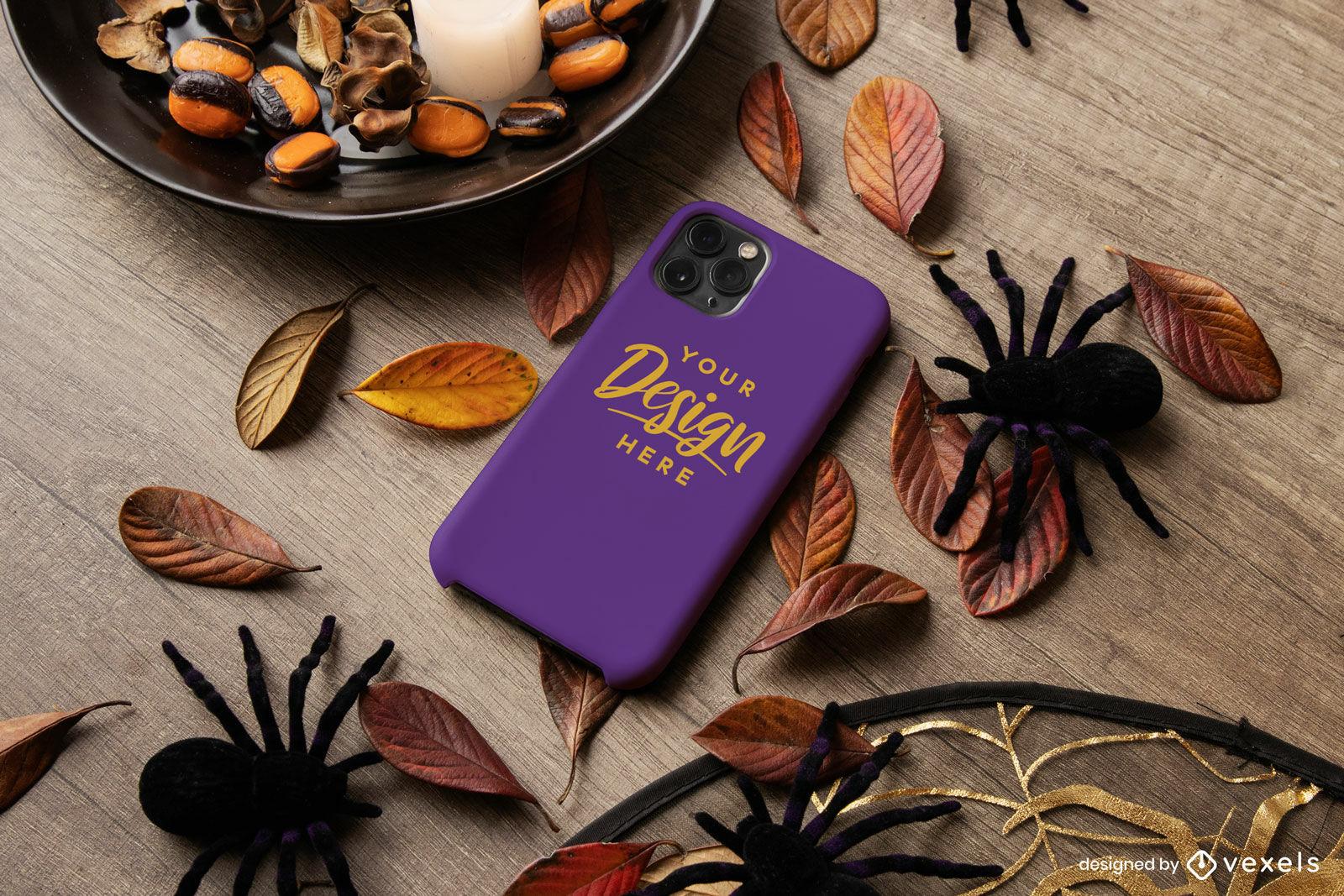 Capa de telefone roxa com maquete de composição de halloween