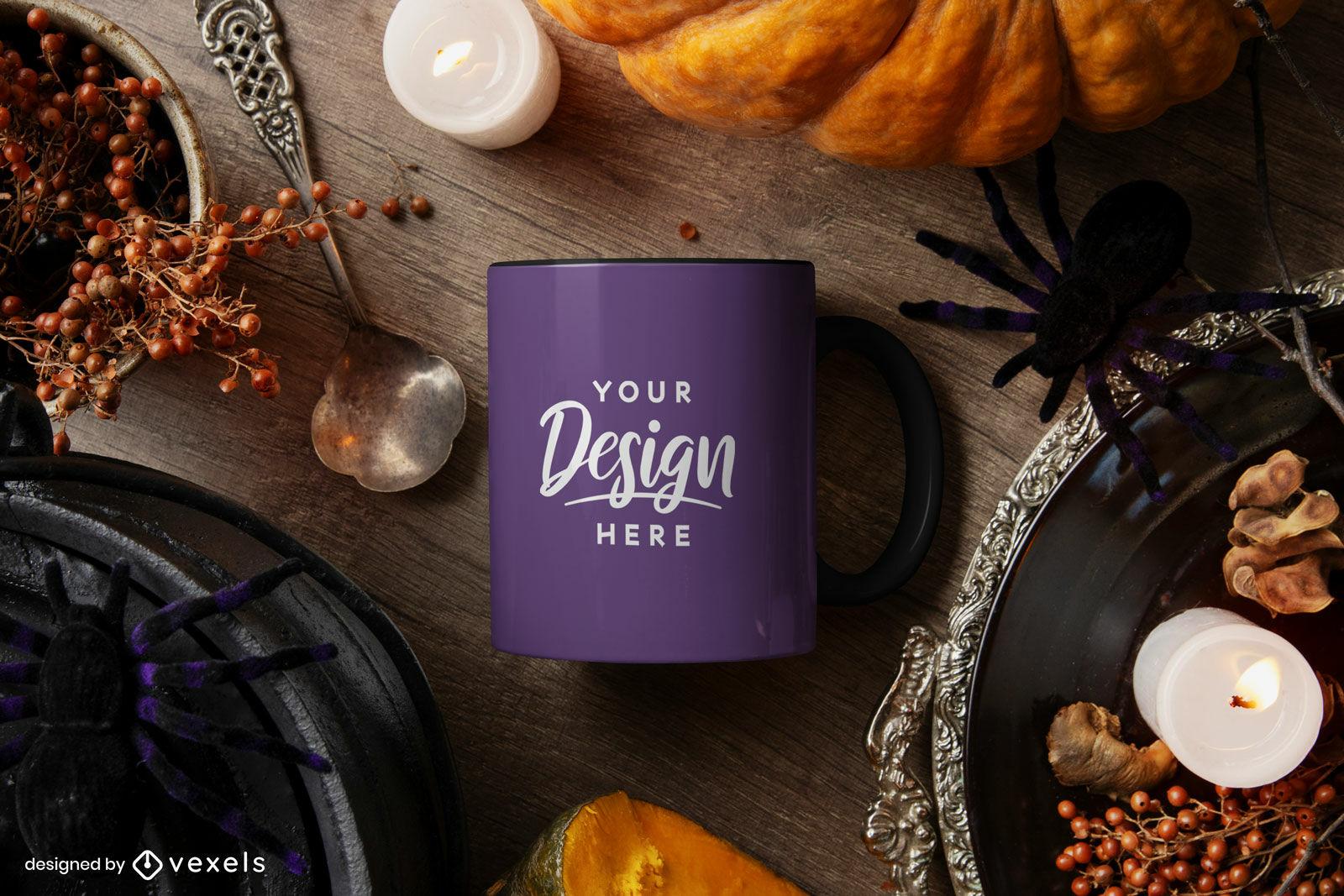 Maqueta de taza morada en composición de halloween