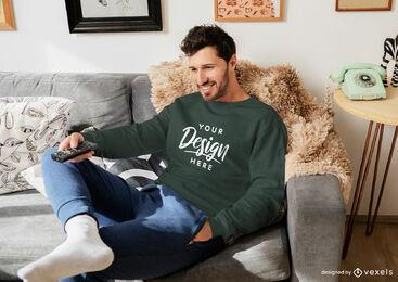 Green sweatshirt mockup man in living room sitting