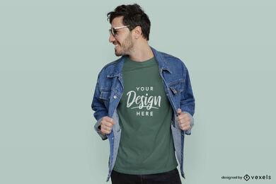Hombre de camiseta verde en maqueta de chaqueta y gafas de sol