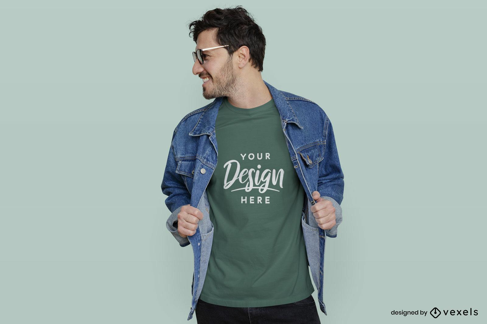 Homem de camiseta verde com jaqueta e maquete de óculos de sol
