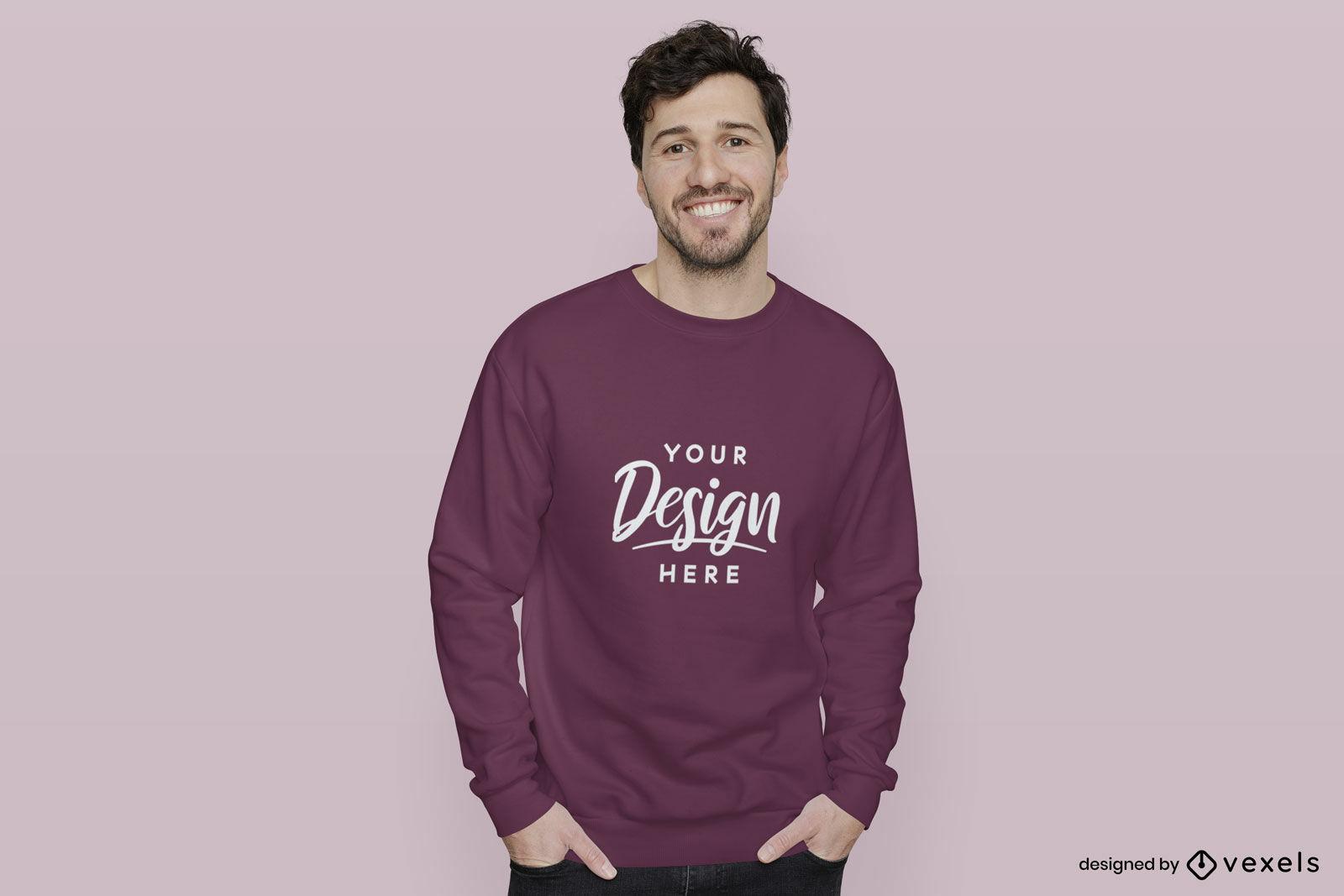 Dunkelvioletter Sweatshirtmann im rosa Hintergrundmodell