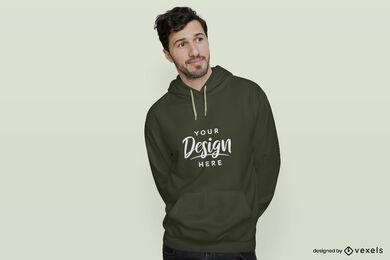 Man in dark green hoodie flat background mockup