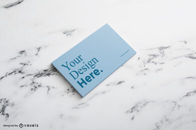 Blue business card in marble surface mockup