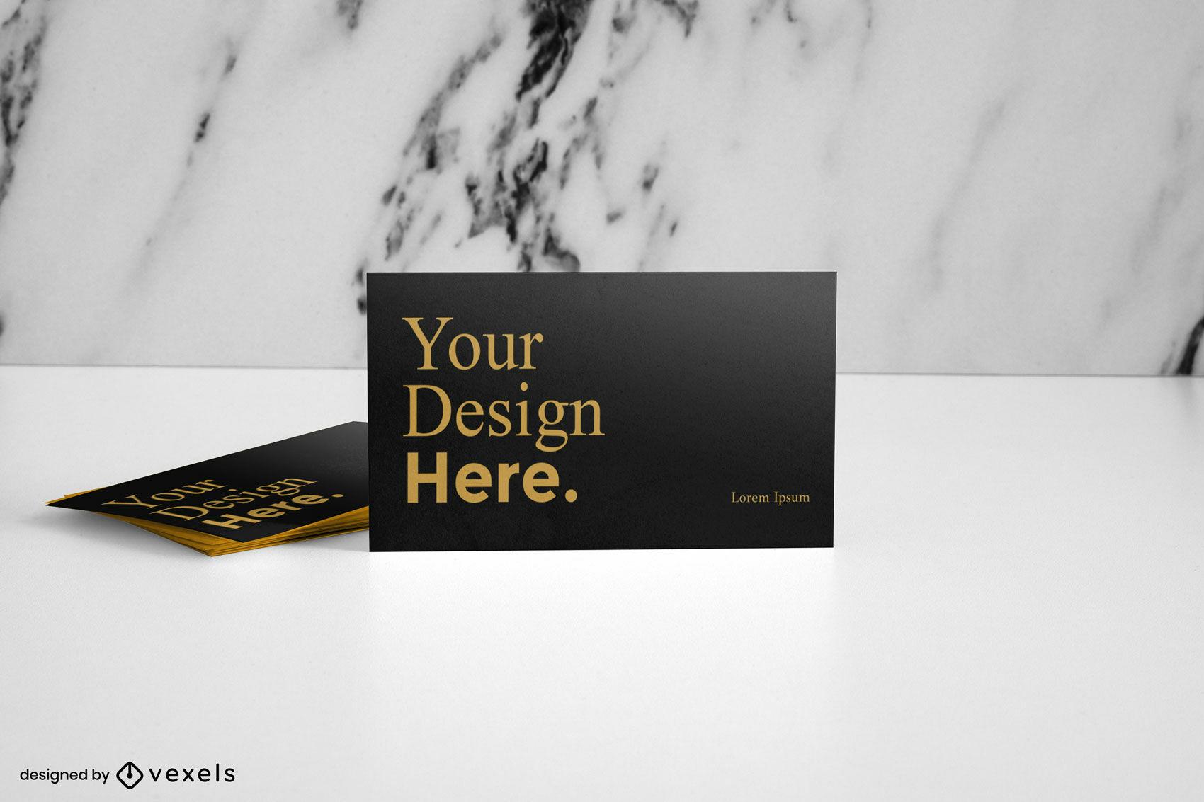 Maquete de cartão de visita preto e dourado