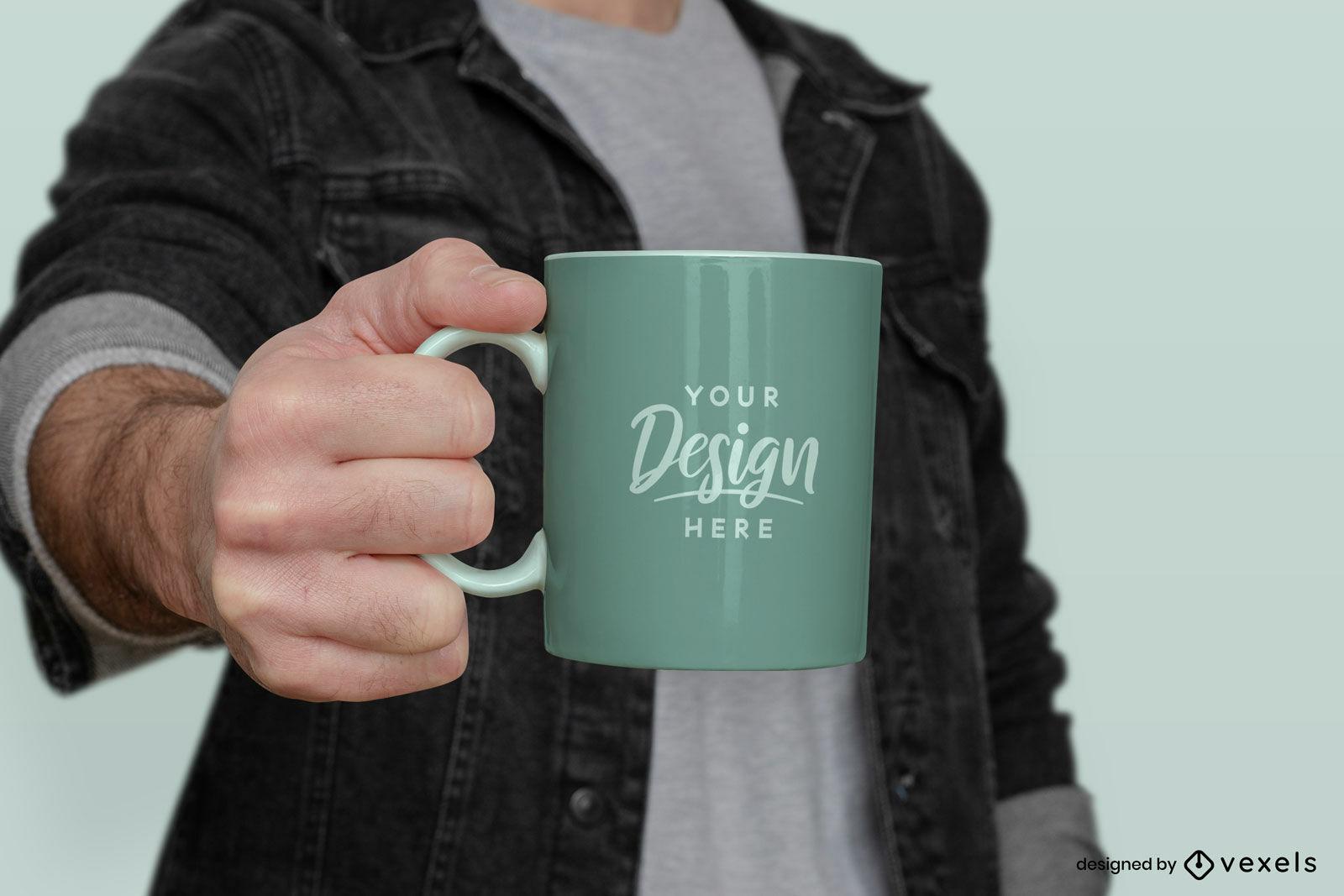 Man in jean jacket holding mug mockup